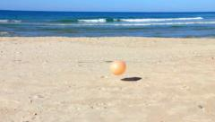 children's balloon escaped  on the sand beach - super slow motion shot - stock footage