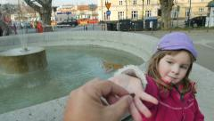 HD Slow-Mo: Sweet Little Girl at Fountain of Wish Stock Footage