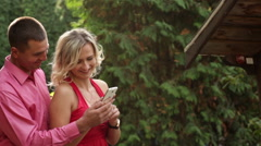 Stock Video Footage of couple in love in the park with phone