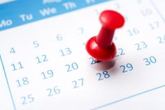 Stock Photo of close up of calendar pinned with thumbtack
