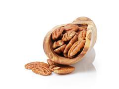 pecan nuts in wood scoop - stock photo