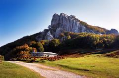 shelter under a rocky mountain - stock photo