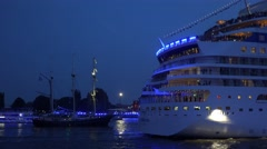 4k AIDA Stella blue illuminated stern leaving Hamburg harbor sailboats Stock Footage