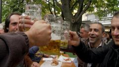 Men Clinking Glasses of Beer - stock footage