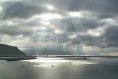 Sunbeams on the sea with sailboats Stock Photos