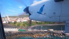 Plane landing in Vila do Corvo, Corvo Island, Azores, Portugal Stock Footage