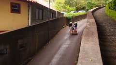 Wicker Toboggan Sled Ride on Madeira, Portugal - stock footage