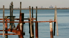 Old docks on detroit river skyline south Stock Footage