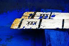 Rusty oars in a blue boat Stock Photos
