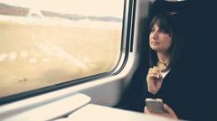 Woman using smartphone in train. Handheld shot - stock footage