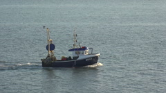 Fishing boat comes back into harbour in southampton water, england Stock Footage