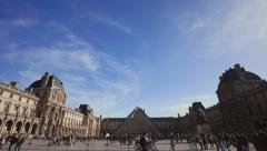 Wide establishing shot of the louvre museum with the pyramide Stock Footage