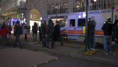 British Police vans are surrounded by protesters in London Stock Footage