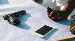 Closeup of Revolver and cell phone on the table Stock Footage