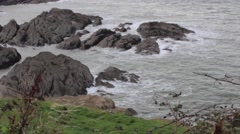 Rocky coast with waves crashing Stock Footage