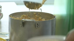 Porridge-pots in the plate large spoon superimposed Stock Footage