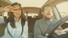 Beautiful woman and handsome man dancing in car with sun light filter Stock Footage