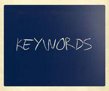"The word ""Keywords"" handwritten with white chalk on a blackboard Stock Photos"