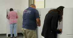 3 shot of People voting in the Mid term election of 2014, no faces Stock Footage