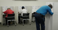 People voting in the Mid term election of 2014 - stock footage