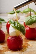 season caprese salad with olive oil - stock photo