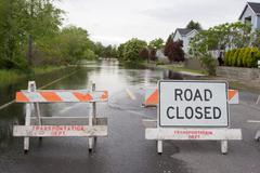 Road Closed Flooded Street - stock photo