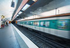 Pairs. metro train speeding up in the subway Kuvituskuvat