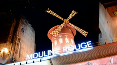 Moulin Rouge cabaret at night in Paris, France. Stock Footage