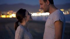 Couple talking and flirting on beach at night HD Stock Footage