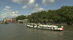 Following Tourist Boat on River Thames Stock Footage