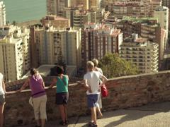 People admire cityscape view in Malaga, Spain NTSC - stock footage