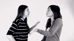 Girlfriend arguing and fighting black and white Stock Footage