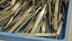 Surgical tools - tweezers stored in a drawer Stock Footage