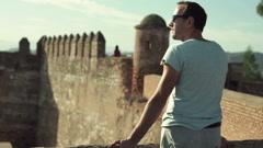 Attractive man admire ancient castle ruins   HD - stock footage
