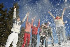 friends have fun at winter on fresh snow - stock photo
