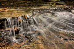 Waterfall in autumn Stock Photos