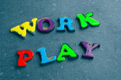 """Children's colorful plastic letters spelling out """"work play"""" Stock Illustration"""