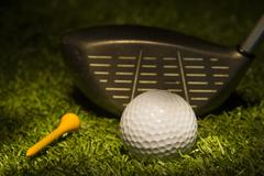 Golf Ball with Club and Tee - stock photo