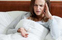 female taking painkillers - stock photo
