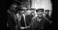 Jewish men discussing amongst themselves on a street Stock Footage