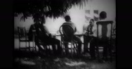 Edward Postell King sitting and talking with officers Stock Footage