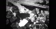 Military soldier talking on field telephone during war Stock Footage