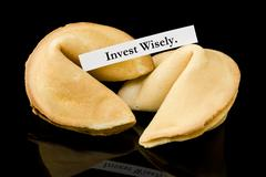"Fortune cookie: ""Invest Wisely."" - stock photo"