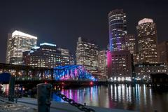 Boston harbor and financial district at night Stock Photos