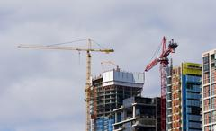 Cranes Constructing Commercial Office Buildings Stock Photos