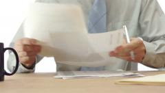 Office Worker Makes Notes On Documents Stock Footage