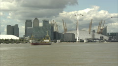 O2 Arena & Canary Wharf Long Shot w/ Boat + Zoom Out Stock Footage