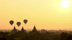 Sunrise at Bagan, air balloons flying over pagodas Stock Footage