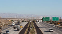 Palm Springs California Freeway Traffic with Wind Farm Interstate 10 Stock Footage