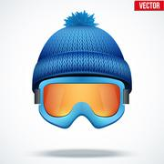 Knitted woolen blue cap with snow goggles. Winter seasonal sport hat. vector Stock Illustration